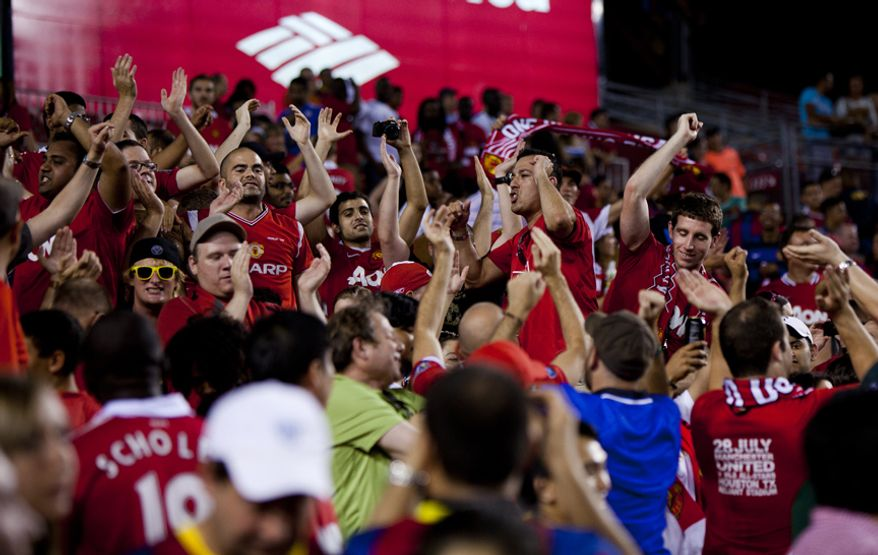 Manchester United fans sing their team's anthems after the 2011 Herbalife World Football Challenge match between Manchester United and FC Barcelona at FedEx Field in Landover, Md. on Saturday, July 30, 2011. Manchester United won the game 2-1. (Pratik Shah/The Washington Times)