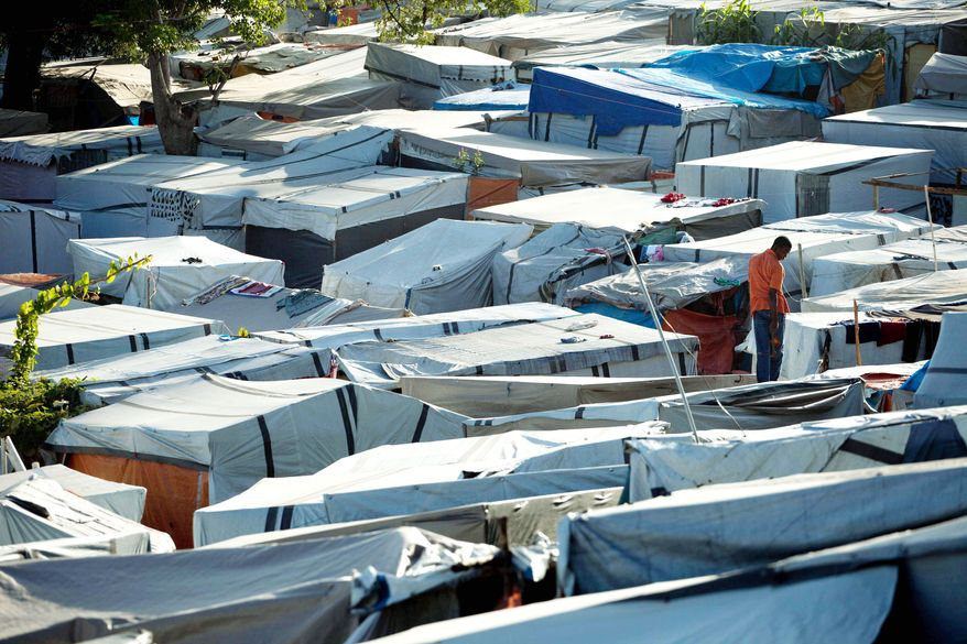 A former golf course is now a refugee camp for people displaced by an earthquake 18 months ago. More than 600,000 people still live in settlement camps. (Associated Press)