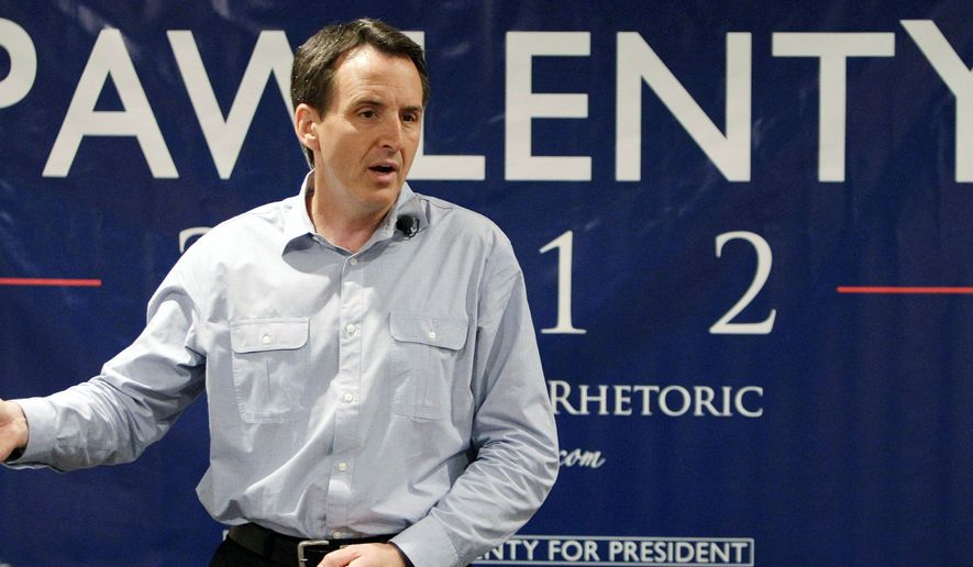 Former Minnesota Gov. Tim Pawlenty speaks to local residents at The Sports Page bar & grill in Indianola, Iowa, on July 20. He is among Republican presidential candidates refusing to sign a pledge denouncing gay marriage. But gay activists intend to eventually pin him down on his attitude. (Associated Press)