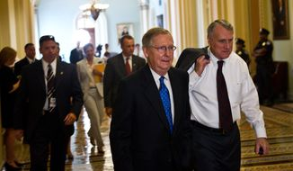 Senate Minority Leader Mitch McConnell (right), Kentucky Republican, and Minority Whip Jon Kyl, Arizona Republican, head to a caucus meeting on Aug. 1, 2011, with fellow Republicans on Capitol Hill to discuss the debt plan. (Drew Angerer/The Washington Times)