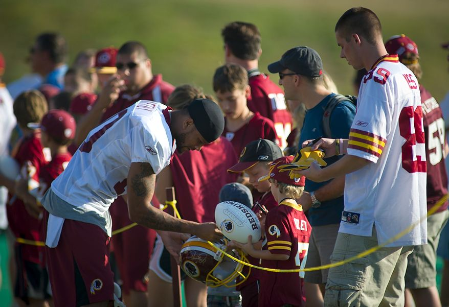 Washington Redskins wide receiver Jabar Gaffney (10) signs autographs as he arrives on the field for another day of training camp at Redskins Park in Ashburn, Va., Monday, August 1, 2011. (Rod Lamkey Jr./The Washington Times)67