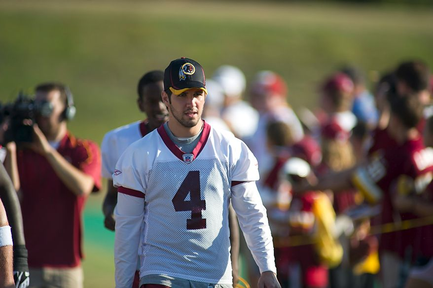 Washington Redskins kicker Graham Gano (4) arrives on the field for another day of training camp at Redskins Park in Ashburn, Va., Monday, August 1, 2011. (Rod Lamkey Jr./The Washington Times)