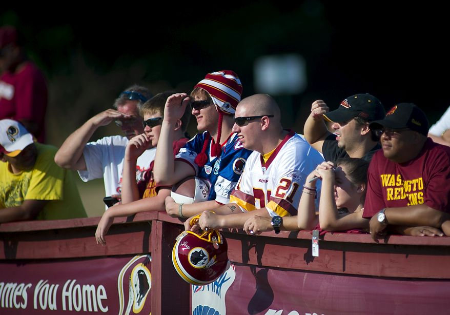 Fans line up along the side lines as the Washington Redskins arrive for another day of training camp at Redskins Park in Ashburn, Va., Monday, August 1, 2011. (Rod Lamkey Jr./The Washington Times)