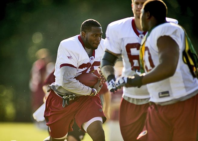 Washington Redskins running back Keiland Williams (35) carries the ball during drills during another day of training camp at Redskins Park in Ashburn, Va., Monday, August 1, 2011. (Rod La