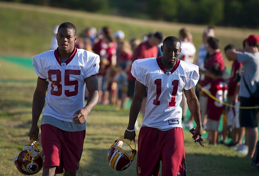 Washington Redskins wide receivers Leonard Hankerson (85) and Aldrick Robinson (11) arrive on the field for another day of training camp at Redskins Park in Ashburn, Va., Monday, August 1, 2011. (Rod Lamkey Jr./The Washington Times)