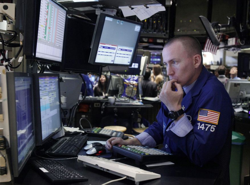 Specialist James Ahrens works on the floor of the New York Stock Exchange on Aug. 1, 2011. (Associated Press)