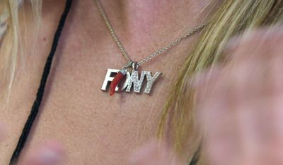 Associated Press Caitlin Leavey wears a special necklace in honor of her father, a New York City firefighter who died in a rescue mission in response to the World Trade Center attacks.