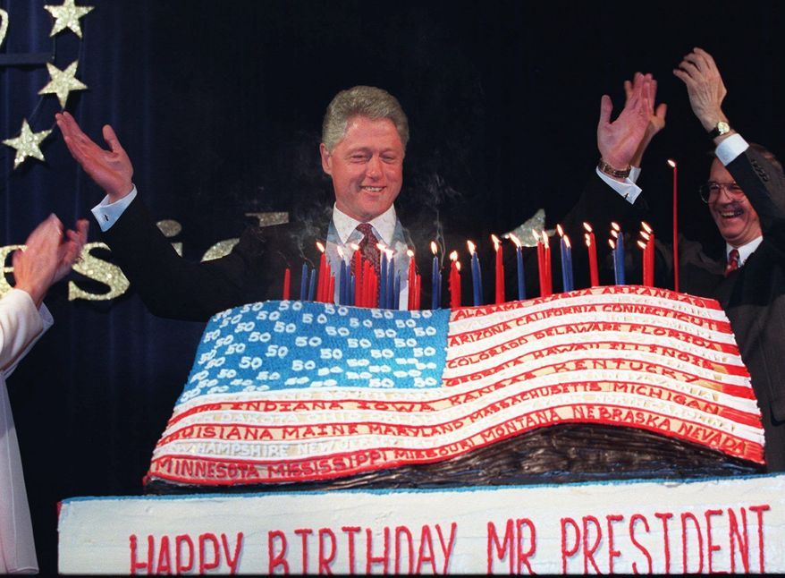 President Clinton celebrates his 50th birthday on Aug. 18, 1996, with a 300-pound American flag cake. President Obama's 50th, being celebrated at Chicago's Aragon Ballroom on Wednesday, promises to be equally lavish. (Associated Press)