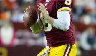 Redskins quarterback Rex Grossman threw for 884 yards and seven touchdowns with an 81.2 passer rating in 2010. (Associated Press)