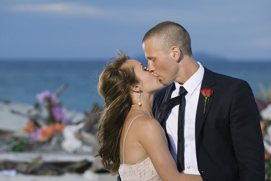 """In this photo provided by ABC, """"The Bachelorette,"""" Ashley Hebert kisses J.P. Rosenbaum on the season finale in Fiji. Hebert chose the 34-year-old construction manager over winemaker Ben Flajnik from California in Monday's two-hour finale. (AP Photo/ABC, Matt Klitscher)"""