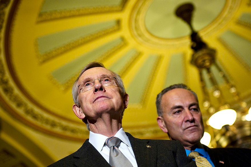 Senate Majority Leader Harry Reid, D-Nev., and Sen. Chuck Schumer, D-N.Y., speak to the media after the Senate passed the debt ceiling plan, on Capitol Hill, in Washington, D.C., Tuesday, Aug. 2, 2011. (Drew Angerer/The Washington Times)