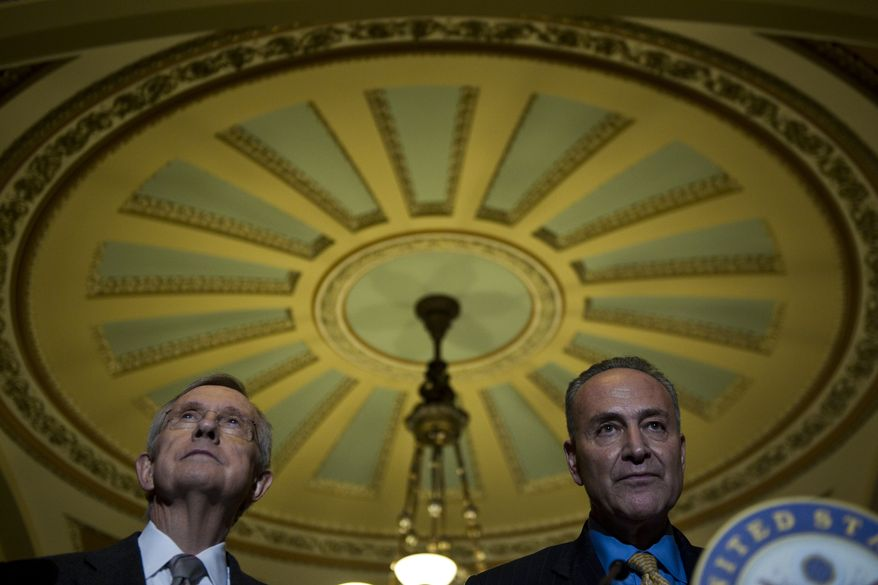 Senate Majority Leader Harry Reid, Nevada Democrat, and Sen. Charles E. Schumer, New York Democrat, speak to the media on Capitol Hill after the Senate passed the debt ceiling plan on Aug. 2, 2011. (Drew Angerer/The Washington Times)