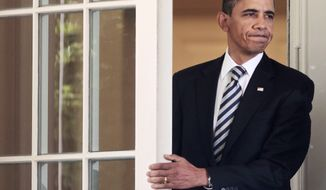 President Obama walks out Aug. 2, 2011, to deliver a statement at the White House following the Senate's passing of the debt ceiling agreement. (Associated Press)