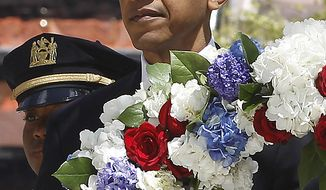 **FILE** President Obama lays a wreath at the National Sept. 11 Memorial at Ground Zero in New York on May 5, 2011. (Associated Press)