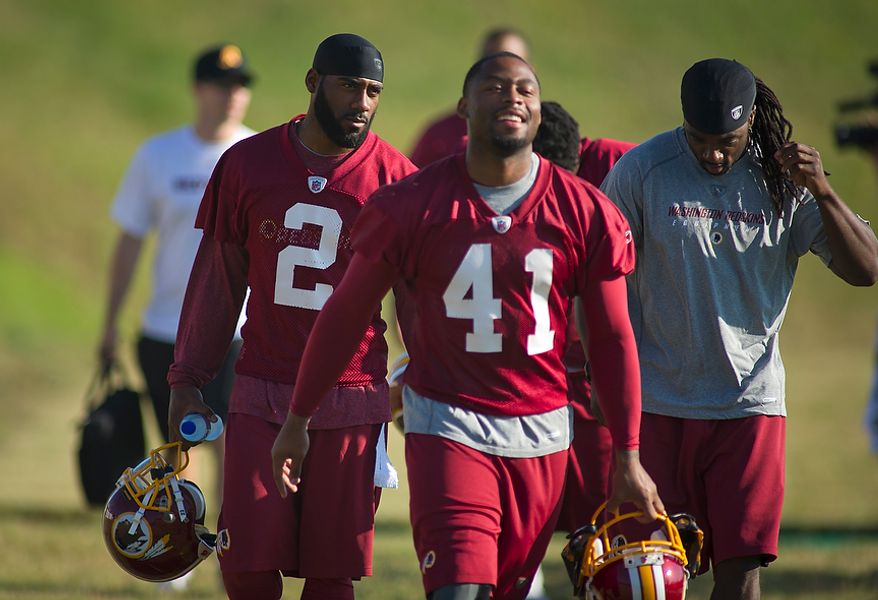 Washington Redskins make their way to the practice field during training camp at Redskins Park in Ashburn, Va., Tuesday, August 2, 2011. (Rod Lamkey Jr./The Washington Times)