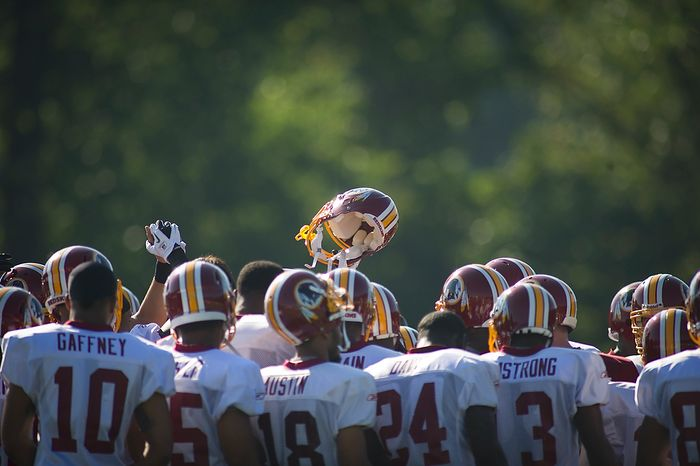 Washington Redskins gather before going into practice drills during training camp at Redskins Park in Ashburn, Va., Tuesday, August 2, 2011. (Rod Lamkey Jr./The Washington Times)