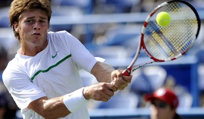 Ryan Harrison returns a shot to Mischa Zverev during a match at the Legg Mason Classic on Tuesday. The 19-year-old American won, 6-3, 1-6, 6-1. (AP Photo/Nick Wass)