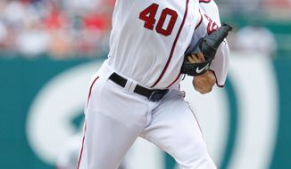 Washington Nationals starting pitcher Chien-Ming Wang (40) from Taiwan throws a pitch during the first inning of a baseball game against the Atlanta Braves at Nationals Park in Washington, Wednesday, Aug. 3, 2011. (AP Photo/Manuel Balce Ceneta)