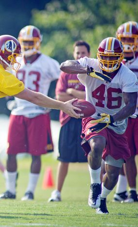 Washington Redskins first-string running back Ryan Torain injured his hand in practice Wednesday and is set to visit a hand specialist. Coaches are confident that he will not miss more than a few weeks if it is fractured. (Rod Lamkey Jr./The Washington Times)