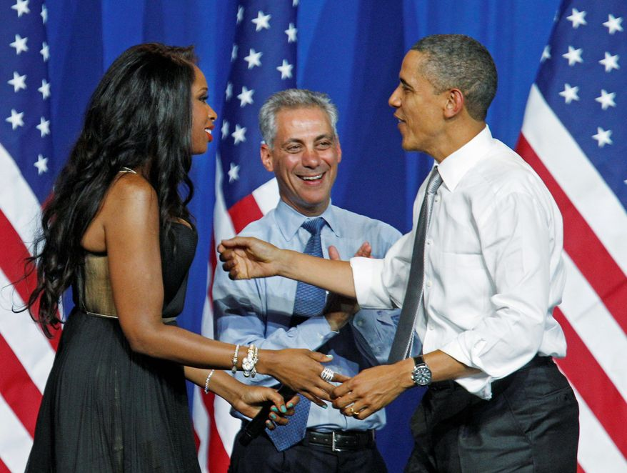 """Mr. Obama is welcomed by singer Jennifer Hudson and Chicago Mayor Rahm Emanuel at a Chicago fundraiser Wednesday. One Republican critic said of the president: """"The first job Obama is interested in saving is his own."""" (Associated Press)"""