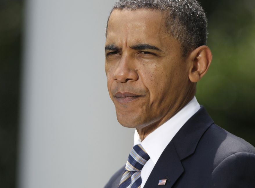 President Barack Obama pauses as he speaks in Rose Garden of the White House in Washington, Tuesday, Aug. 2, 2011, after the Senate passed the debt ceiling legislation. (AP Photo/Carolyn Kaster)