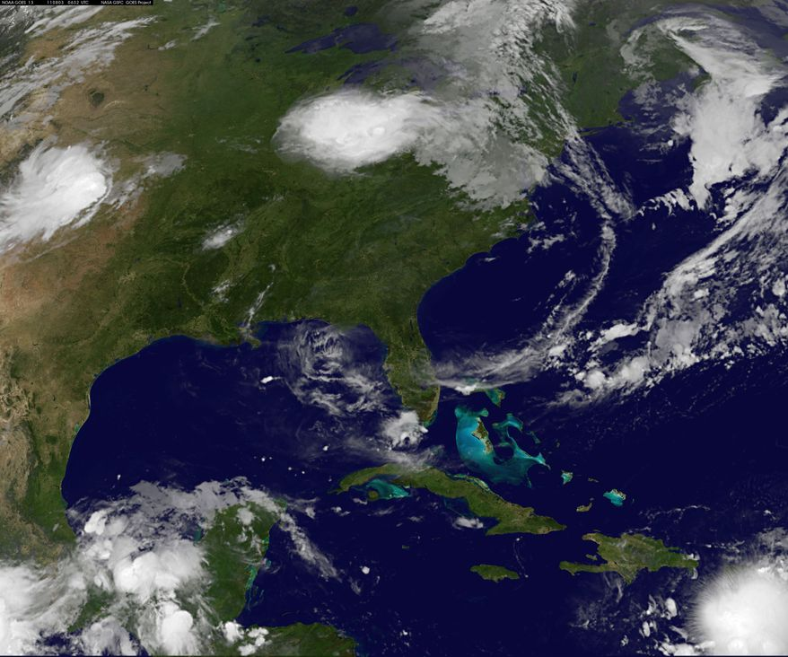 This image taken at 2:32 a.m. EDT on Aug. 3, 2011, shows Tropical Storm Emily. The storm brushed past Puerto Rico and set its sights on the Dominican Republic and Haiti, where more than 630,000 people are still without shelter after last year's earthquake. (Associated Press/NASA)