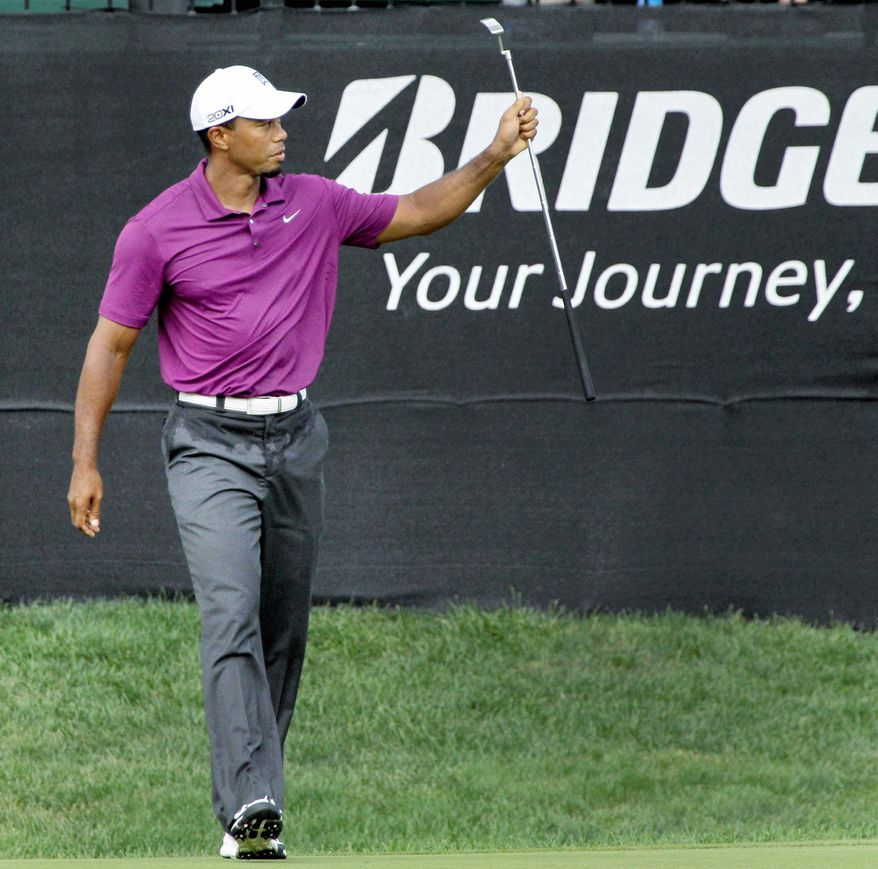 ASSOCIATED PRESS Tiger Woods reacts after making birdie on the 16th hole during the first round of the Bridgestone Invitational in Akron, Ohio.