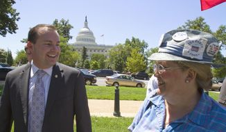 **FILE** In this photo from July 27, 2011, Sen. Mike Lee, Utah Republican, greets a supporter at a tea party rally on Capitol Hill. (Associated Press)