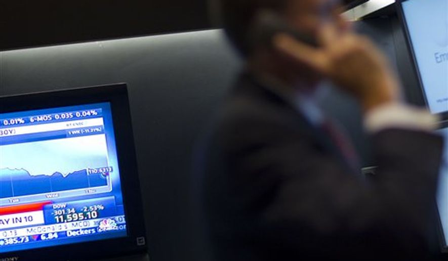 A monitor displays Dow Jones Industrial Average from the floor of the New York Stock Exchange on Thursday, Aug. 4, 2011 in New York. The Dow Jones industrial average plunged more than 300 points and erased its gains for the year as investors grew more concerned about economic weakness in the U.S. and Europe. (AP Photo/Jin Lee)
