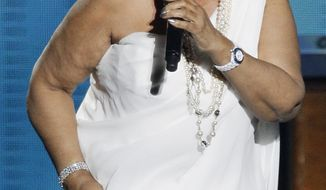 """** FILE ** In this Tuesday, May 17, 2011, file photo, Aretha Franklin performs during a star-studded double-taping of """"Surprise Oprah! A Farewell Spectacular,"""" in Chicago. (AP Photo/Charles Rex Arbogast, File)"""