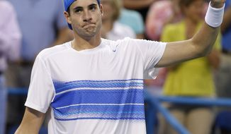 John Isner  acknowledges the crowd after defeating James Blake 7-6 (0), 1-6, 7-6 (4) at the Legg Mason Tennis Classic on Thursday. (AP Photo/Luis M. Alvarez)