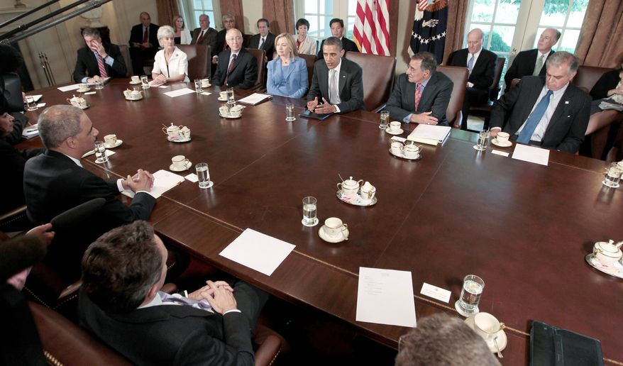 President Obama presides at a Cabinet meeting on Wednesday. In the background from left are Education Secretary Arne Duncan, Health and Human Services Secretary Kathleen Sebelius, Interior Secretary Kenneth L. Salazar, Secretary of State Hillary Rodham Clinton, the president, Defense Secretary Leon E. Panetta and Transportation Secretary Ray LaHood. In the foreground from left are, Labor Secretary Hilda L. Solis, Attorney General Eric H. Holder Jr. and Treasury Secretary Timothy F. Geithner. (Associated Press)