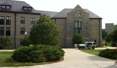 "** FILE ** Peddrew-Yates Residence Hall, near Dietrick Dining Center, is locked down on Thursday, Aug. 4, 2011, on the Virginia Tech Campus in Blacksburg, Va., after three youths attending a summer camp on Virginia Tech's campus said they saw a man outside New Residence Hall East ""holding what may have been a handgun,"" the university said. (AP Photo/The Roanoke Times, Rebecca Barnett)"
