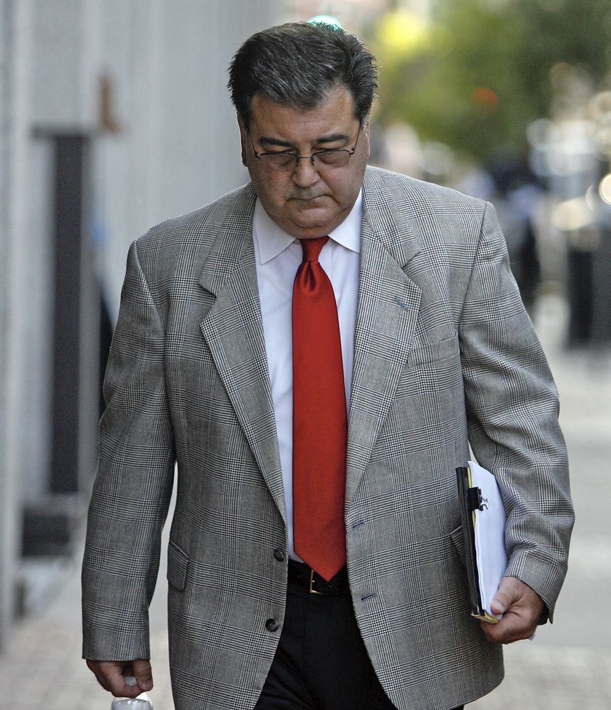 "** FILE ** Retired New Orleans police Sgt. Arthur ""Archie"" Kaufman, charged with covering up the deadly shootings of civilians on the Danziger Bridge in New Orleans in the aftermath of Hurricane Katrina, enters federal court on Monday, July 11, 2011, in New Orleans. (AP Photo/The Times-Picayune, Ted Jackson)"