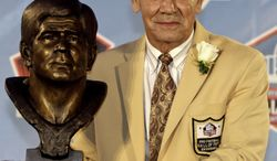 Chris Hanburger poses with a bust of himself during the induction ceremony at the Pro Football Hall of Fame on Saturday. (AP Photo/Tony Dejak)