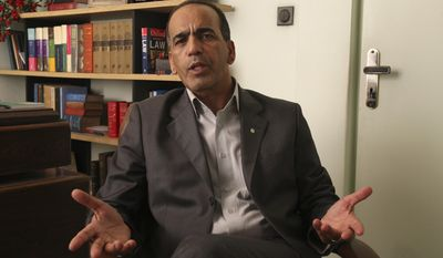 Masoud Shafiei, the Iranian lawyer for two Americans who have been jailed in Iran on charges of espionage, speaks at his office in Tehran, Iran, Saturday, July 30, 2011. Two Americans could be released after a court hearing slated for Sunday, their lawyer said. (AP Photo/Vahid Salemi)