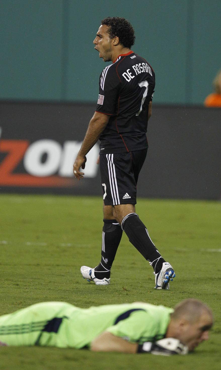 D.C. United's Dwayne De Rosario (7) celebrates after scoring his second goal of three goals against Toronto FC. The game ended in a 3-3 tie after Rosario scored a penalty kick in the 88th minute. (AP Photo/Luis M. Alvarez)