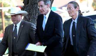 ** FILE ** Warren Jeffs (center) is taken into the side entrance of the Tom Green County Courthouse in San Angelo, Texas, on Monday, Aug. 8, 2011. (AP Photo/San Angelo Standard-Times)