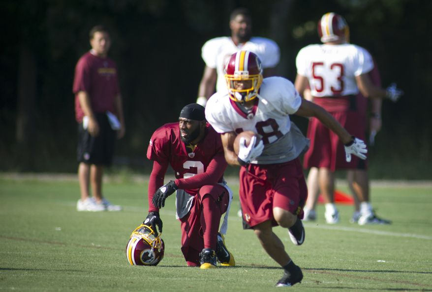 Washington Redskins cornerback DeAngelo Hall (left) takes a rest during training camp at Redskins Park in Ashburn, Va., on Monday, Aug. 8, 2011. (Rod Lamkey Jr./The Washington Times)