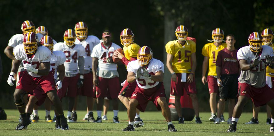 Washington Redskins quarterback Ben Chappell (2) drops back for a pass during training camp at Redskins Park on Monday, Aug. 8, 2011. (Rod Lamkey Jr./The Washington Times)