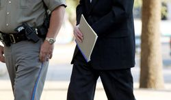 ASSOCIATED PRESS Convicted polygamist leader Warren Jeffs is escorted into the courthouse in San Angelo, Texas, on Tuesday for sentencing. He received life in prison and a consecutive 20-year term.