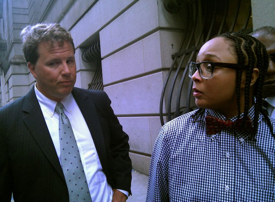 """ASSOCIATED PRESS Felicia """"Snoop"""" Pearson, seen outside a Baltimore courthouse Monday with her attorney, Benjamin C. Sutley, pleaded guilty to conspiring to distribute heroin. Miss Pearson played a Baltimore drug gang assassin in HBO's """"The Wire."""""""