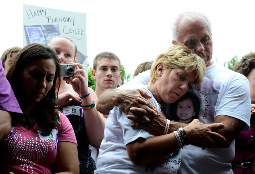 Cindy Anthony is comforted by George Anthony, right, during a memorial ceremony at the site where the body of their granddaughter Caylee Anthony was found on what would have been her sixth birthday in Orlando, Fla., Tuesday, Aug. 9, 2011.  Their daughter Casey Anthony was acquitted of the most serious charges related to the death of Casey's daughter, Caylee Anthony. (AP Photo/Phelan M. Ebenhack)
