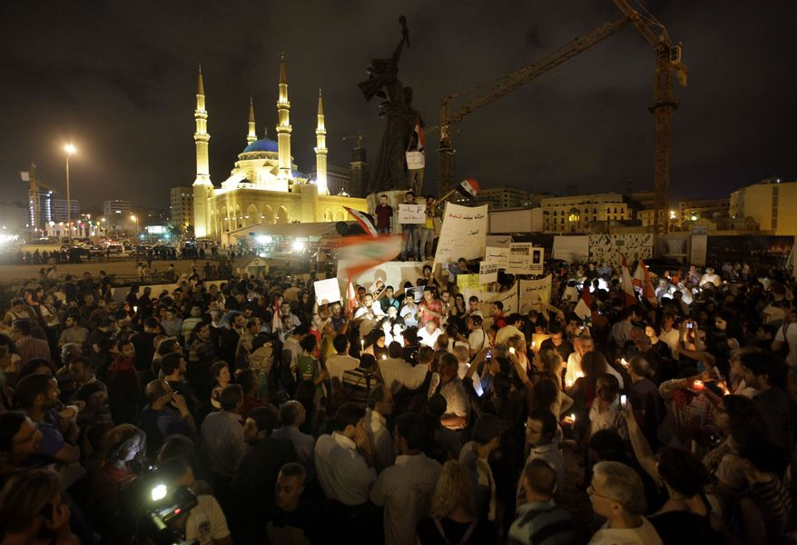 Lebanese intellectuals and journalists protest during a vigil sit-in to show their support to the Syrian protesters who demonstrate against the Syrian President Bashar Assad, at the Martyrs square, in downtown of Beirut, Lebanon, on Monday, Aug. 8, 2011. (AP Photo/Hussein Malla)