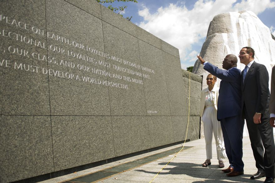 President and CEO of the Martin Luther King, Jr. National Memorial Project Foundation Harry E. Johnson gestures while giving D.C. Mayor Vincent Gray and Del. Eleanor Holmes Norton a tour at the site of the new Martin Luther King Jr. National Memorial, in Washington, D.C., Wednesday, Aug. 10, 2011. (Drew Angerer/The Washington Times)