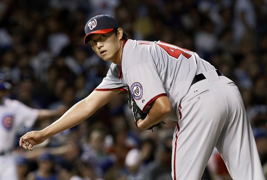 Washington Nationals starting pitcher Chien-Ming Wang will pitch in the first game of Thursday's doubleheader against the Los Angeles Dodgers. (AP Photo/Charles Rex Arbogast)