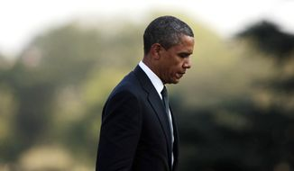 President Obama arrives at the White House on Aug. 9, 2011, after making an unannounced trip to Dover Air Force Base, in Dover, Del., to pay tribute to the 30 U.S. troops killed over the weekend in Afghanistan. (Associated Press)