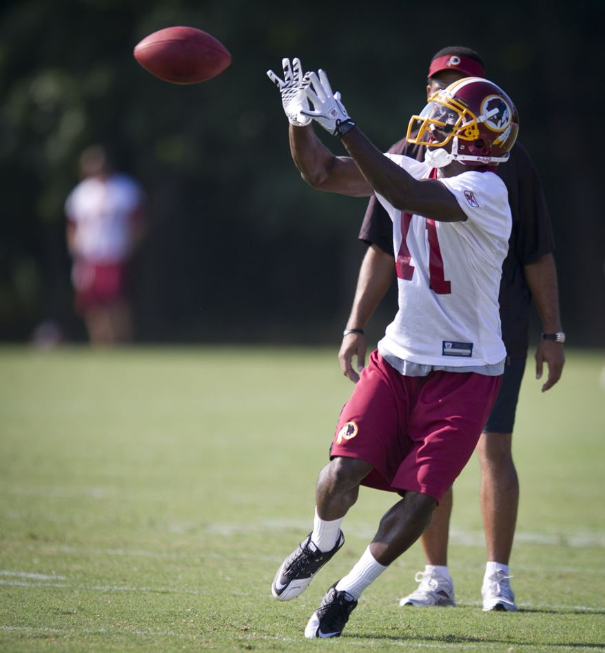Wide receiver Aldrick Robinson pulls down a pass during drills. (Rod Lamkey Jr./The Washington Times)
