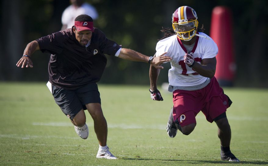 Wide receiver Donte Stallworth, right, gets past wide receivers coach Keenan McCardell during drills. (Rod Lamkey Jr./The Washington Times)