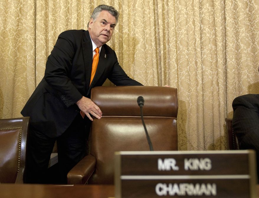 House Homeland Security Committee Chairman Rep. Peter King, New York Republican, arrives on Capitol Hill in Washington, Wednesday, July 27, 2011, for the committee's hearing on Islamic radicalization in the US, focusing on recruitment within the Muslim American community. (AP Photo/Evan Vucci)